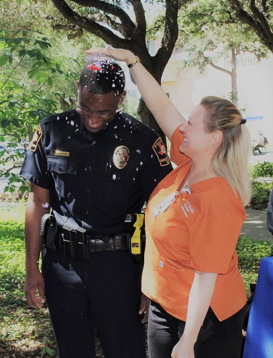UT Police officer helping a student on campus