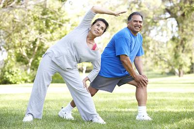 Senior Hispanic couple exercising outdoors
