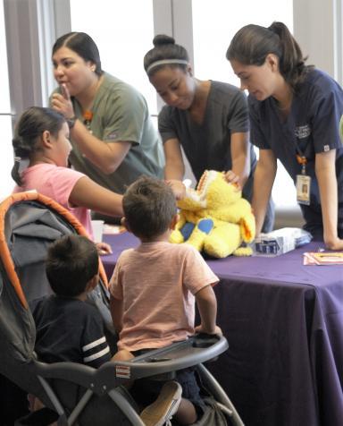 Dental students teach children oral hygiene care at Haven for Hope.