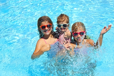 kids in the pool for a summer swim
