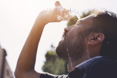 hispanic male hydrating