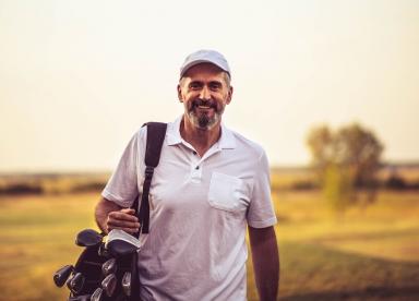 Confident man playing golf