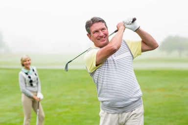 Middle aged man playing golf