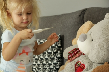 Toddler holding thermometer