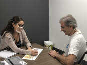 Speech-language pathology student works with patient in summer adult education program