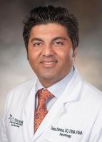Dr. Reza Behrouz