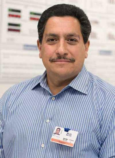 Walter Mejia works with researchers to help keep equipment running smoothly at the South Texas Research Facility