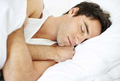 Dental patient sleeping soundly after being successfully treated for sleep apnea