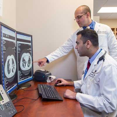 CTRC doctors evaluating anti-cancer drugs in vitro