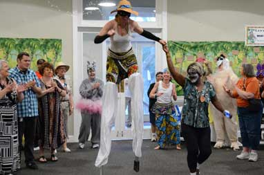 Stilt dancers entertain at a recent Surviving and Thriving conference.