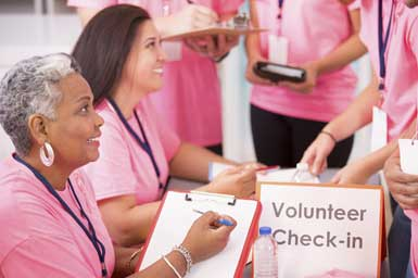 Our cancer support community volunteers help at check in during a recent breast cancer awareness event.